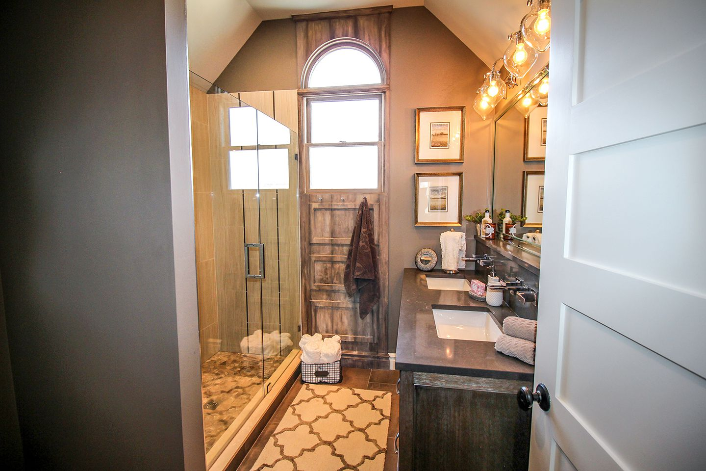 Five panel door as entry to master bathroom