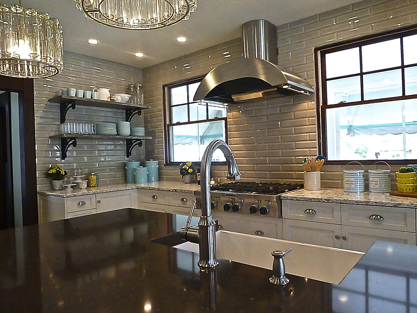 industrial range hood with country farm sink