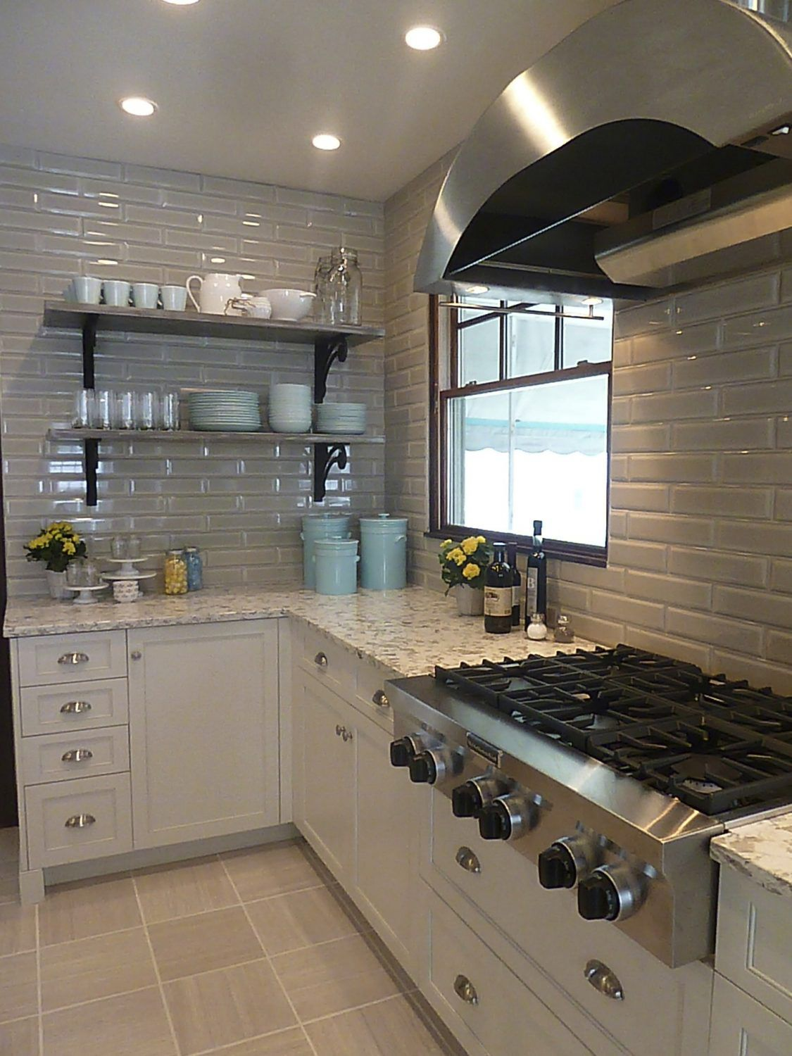 rustic open shelves mounted on subway tile