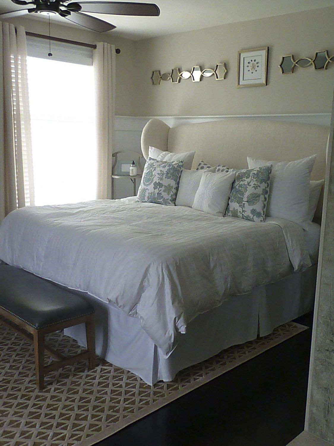 upholstered headboard compliments custom wainscoting